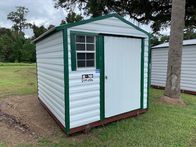 white shed with green trim